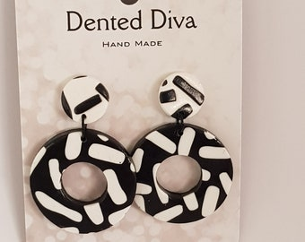 Dented Diva. Clay earrings. Black and white hoop dangle