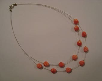 Double necklace with coral beads