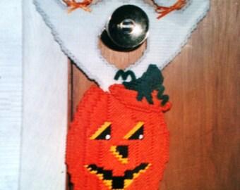 two ghosts in a pumpkin door hanger needlepoint plastic canvas