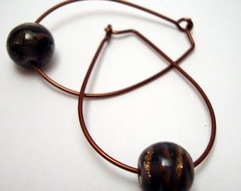 Pear shaped copper hoop earrings with plum purple art glass bead