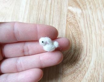 Tiny needle felted bunny.