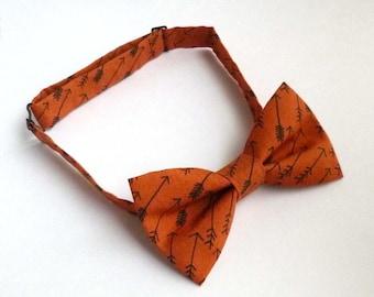 Rust orange bow tie with black hand drawn style arrows – pre tied