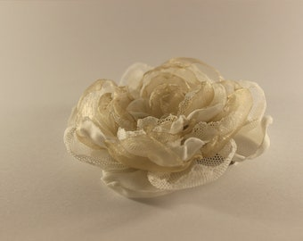 Hand made white and gold flower broach or hair accessory with clip and pin