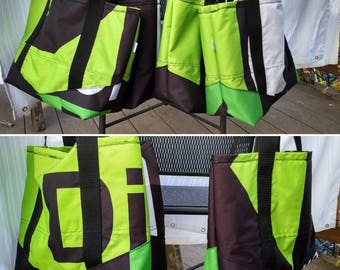 Green and black waterproof tote made from repurposed tent awnings