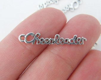 6 Cheerleader charms antique silver tone SP86
