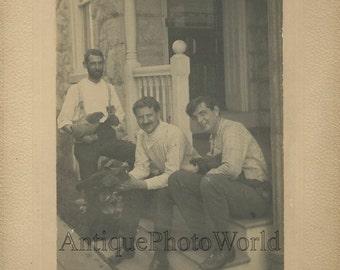 Three handsome men on porch holding chickens fun antique photo