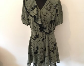 Vintage 70s 80s soft green and black abstract floral dress. French style with RUFFLE neckline