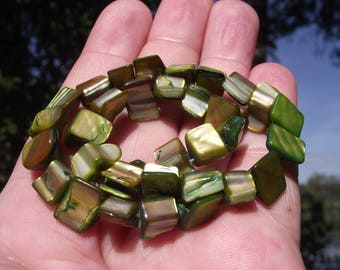 6 GREEN 10-14 MM SHELL BEADS.