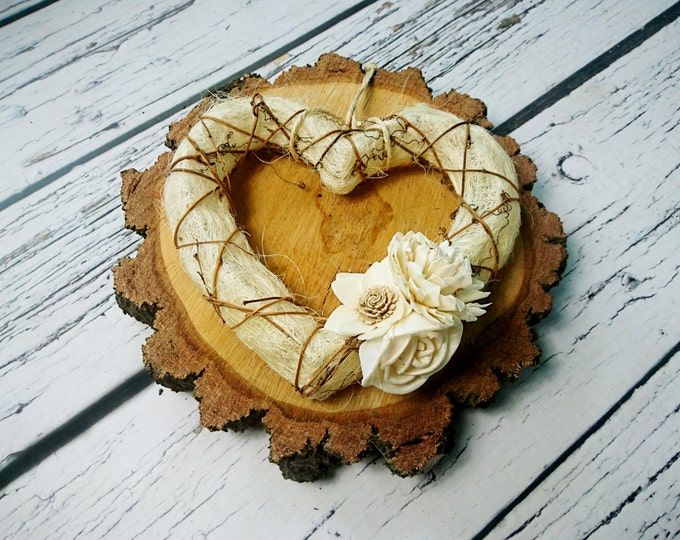 Rustic style wedding heart decor wreath sola flowers centerpiece table hanging cream brown wall background backdrop natural eco
