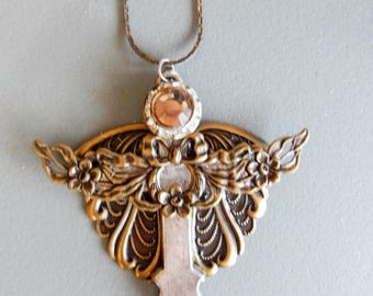 Gold tone wings with Light Pink Crystal Head on silver tone Cross