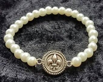 White glass pearl fleur de lis bracelet