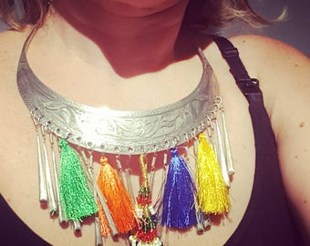 Hmong style silver necklace with pom poms and beaded piece. Silver Hmong necklace, with tassels and bases piece