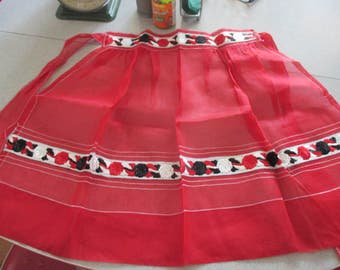 Fantastic New old stock unused Apron Sheer red fabric embroidered at waist and around the bottom