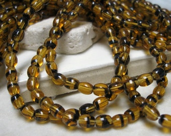 Vintage 5mm Oval Glass Beads in Tortoise.  3 dz.