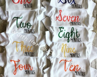 Multicolored Monthly baby onesies (For Baby's first year) 12 piece set