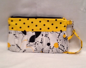 AK7- Compleat Clutch: in a smart graphic flower print with pleated front, zipper closure and detatchable hand strap