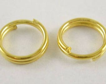 100 rings (5 mm) iron - gold color