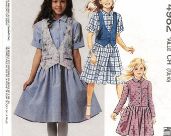A Long/Short Sleeve, Front Button, Dirndle Skirt Dress and Lined, Buttoned Vest Pattern for Girls: Unused - Sizes 7-8-10 • McCall's 4982