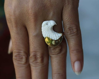 hand carved cow bone eagle head. and brass ring.