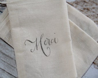 25 Hand stamped muslin favor bags - MERCI - Thank You gift, Wedding favors, Gift bags,Paris themed Wedding, paris wedding, french shower