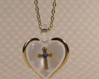 Gold tone heart and cross necklace