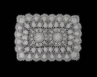 Vintage handmade crocheted doily centerpiece -- light beige crocheted centerpiece with shell-like flowers -- 17.5x12 inches / 44.5x31 cm