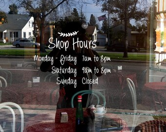 Hand writing style business hours window decal