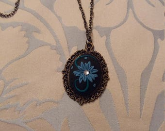 Beautiful necklace from polymer clay in a antique bronze cameo with 16in chain