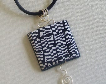 Black and White Checkerboard Pattern Polymer Clay Pendant by Carol Wilson of PollyClayDesigns