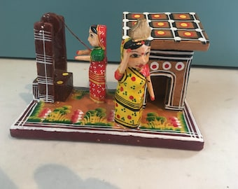 Two Indian ladies at a well, hand carved and painted and boxed