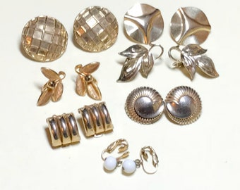 Seven pairs of vintage goldtone metal earrings, leaf and geometric, clip and screw back, vintage earring lot, gold earring lot, 1950-70s E81
