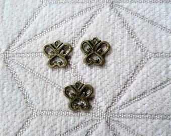 3 medium sized butterfly charms