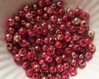 Over 50 vintage light and dark pink loose Mercury glass beads