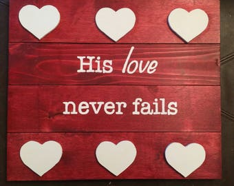 His love never fails sign
