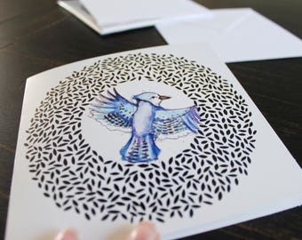 Greeting card with Blue Jay and pattern. White envelope. White, black blue and purple. 5.5 x 5.5 inches.