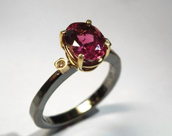 Alternative engagement solitaire ring with an impressive pink tourmaline gemstone and two diamonds, Wedding ring, An artistic ring.