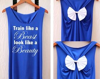 Train like a beast Look like a beauty bow Tank Top. Racerback bow. Disney shirt. Tank Top. Disney Tank Top. Bachelorette Party Tank Tops.