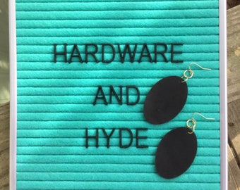 Black leather oval earrings with gold tone hardware