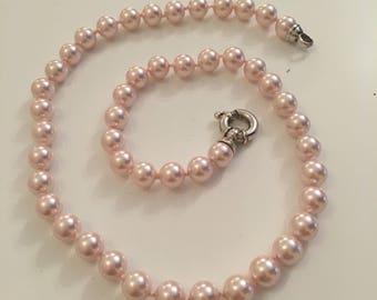 Faux pink pearl neckace