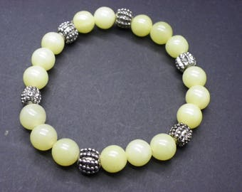 Stone bracelet of yellow lemon jade with some brass spacer