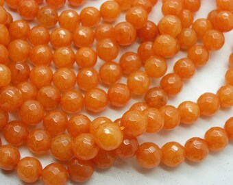 48 jade 8 mm round beautiful coral orange color