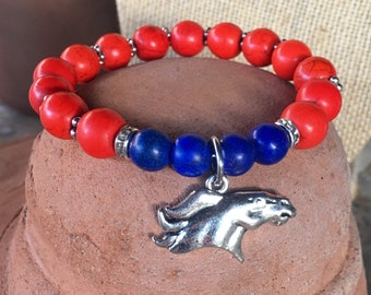 Broncos themed spirit bracelet. Yoga bracelet with orange and blue dyed turquoise beads and bronco charm