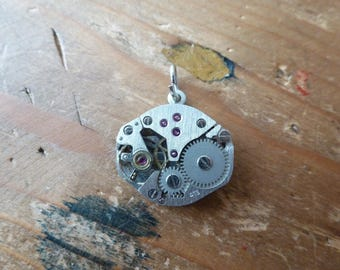 Pendant upcycled old watch mechanism