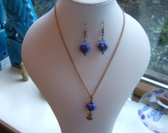 """17"""" Antique Bronze Chain Necklace and Earring Set with Royal Blue Glass Heart Beads."""