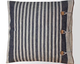 linen pillow. Linen decorative pillow made of ecological material. Striped fabric of untreated flax, wooden buttons, minimalism