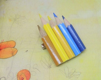 Big brooch with colored pencils, blue and yellow