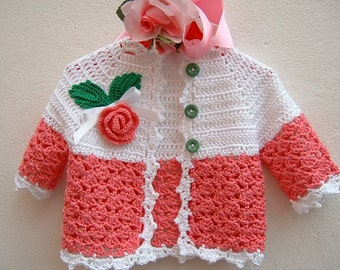 Baby sweater Crochet. Pink and white cotton with a rose in embossed applied. Crochet girl fashion. Romantic sweater for baby girl