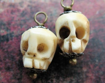 Carved Bone Skull Bead Charms - 1 pair - 18mm in length