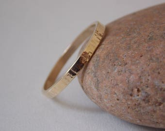 Handmade gold ring. Very fine and modern hammered wedding band.
