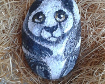 Panda painted on river Stone